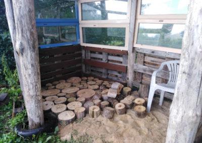 Jardin des cultures - Sol en rondins